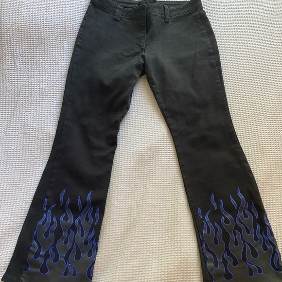 Vintage 90's black flare jeans with blue flames